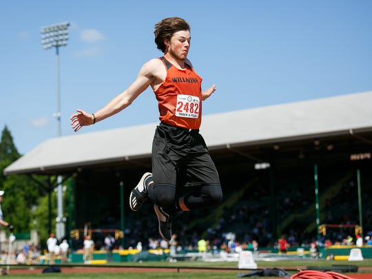 Willamina's David Hensley competes in the 3A boys triple jump at the OSAA Track and Field Championships on Friday, May 18, 2018, at Hayward Field in Eugene.