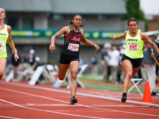 North Salem's Maliyah Thompson runs in the 6A girls