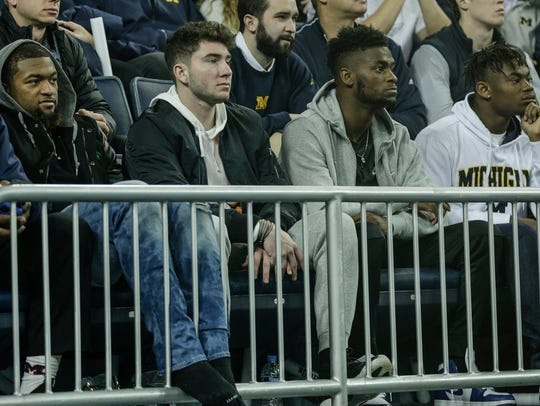Shea Patterson, second from left, watches a Michigan