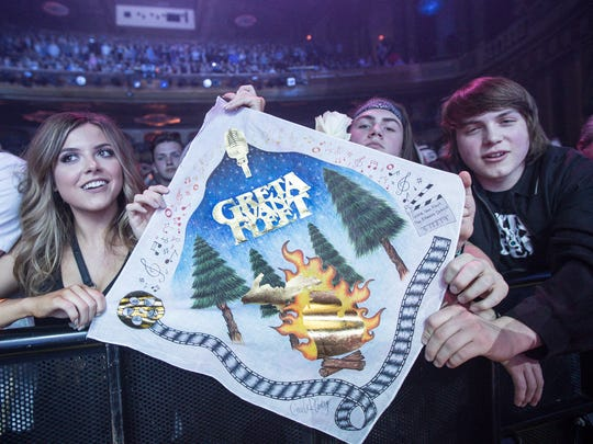 Fans hoist a Greta Van Fleet banner during the band's show at the Fillmore Detroit on May 22, 2018, in downtown Detroit.