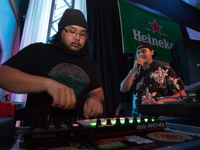 Zach Quinata, left, and Mark Elliot performs raggae
