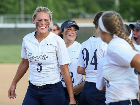 Karli Ricketts (5) celebrates with Decatur Central Hawks after defeating Roncalli Rebels in softball sectionals at Pike High School on May 22, 2018