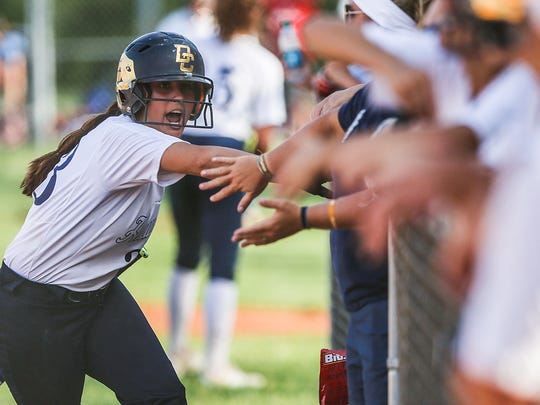 Decatur Central Hawk Chelsey Vaughn (23) pumps up players