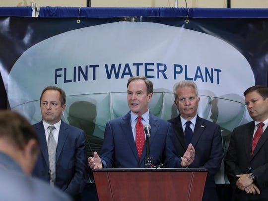 Attorney General Bill Schuette announces new charges against two high-ranking state health officials today in the fourth round of criminal charges in the Flint drinking water crisis on Wednesday June 14, 2017 during a press conference at Riverfront Banquet Center in downtown Flint. Michigan Health and Human Services Director Nick Lyon is charged with involuntary manslaughter and misconduct in office, both felonies. Chief Medical Executive Eden Wells is charged with obstruction of justice and lying to a police officer. Both are charged in connection with the Legionnaires' disease outbreak in the Flint area that led to 12 deaths after the city's water supply was switched to the Flint River in April 2014.