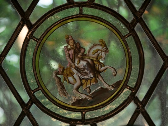 Painted glass, stained glass and leaded glass run throughout