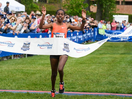 Bizuwork Kasaye, from Ethiopia, crosses the finish