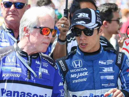 At right, Rahal Letterman Lanigan Racing IndyCar driver Takuma Sato (30) talks with his crew before the 102nd running of the Indianapolis 500 at Indianapolis Motor Speedway on Sunday, May 27, 2018.