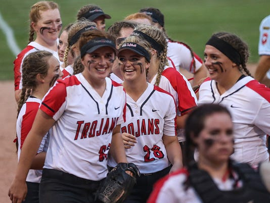 Center Grove Trojans celebrate defeating Shelbyville Golden Bears in softball regionals on May 29, 2018