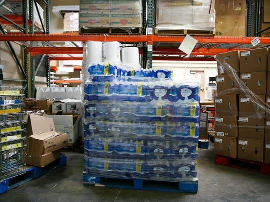 Pallets of water and individual water bottles in the warehouse of Marion Polk Food Share on Wednesday, May 30, 2018. Low levels of toxins caused by algae blooms in Detroit Lake have prompted officials to warn children under 6 years old and those with compromised immune systems to not drink tap water.