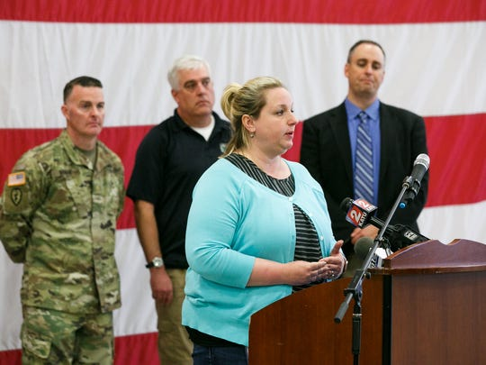 Lacey Goeres-Priest, water quality supervisor for City of Salem, speaks at a press conference to discuss the ongoing contaminated water advisory in Salem on Thursday, May 31, 2018, at the Anderson Readiness Center. The Oregon National Guard will be setting up free water stations around Salem and Stayton on Thursday evening.