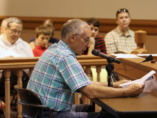 Bob Lacourciere, of Oconomowoc, a member of Defending Our Ixonia Countryside, asks representatives from the Department of Natural Resources to remove two fields in the manure spreading area for Tag Lane Dairy, LLC, Ixonia during a public hearing on May 31 on the farm's Pollutant Discharge Elimination System permit.