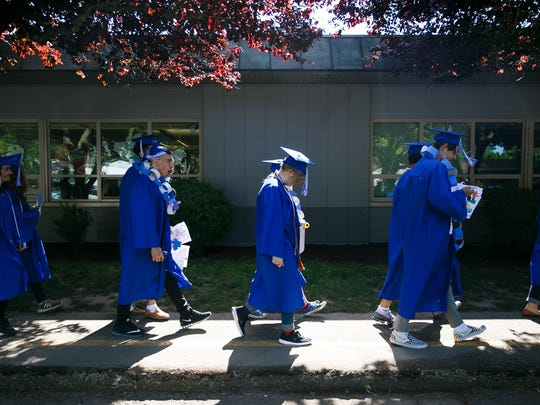 McNary High School students walk to a reception following