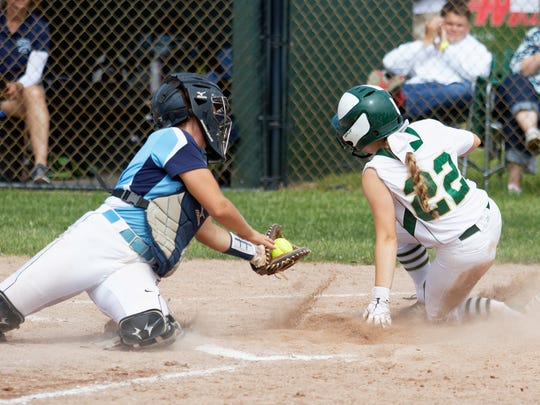 Howell's Maddy Heilner beats the throw home in a 10-1
