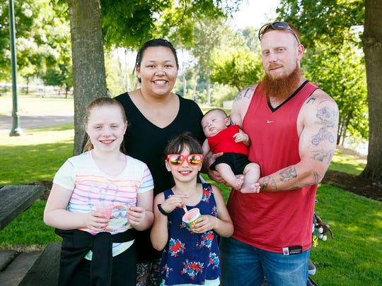 Ellaina Clark and Brandon Hittner with, left to right, Kaimony Hittner, Marria Clark and Wyatt Hittner, in Riverfront Park on Saturday, June 2, 2018. The City announced that the drinking water warning was lifted on Saturday afternoon, but Clark and Hittner said they would still wait a few days before drinking tap water again.