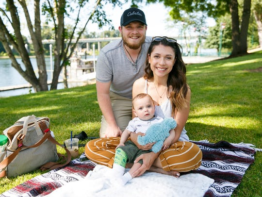 Zach and Jasmine Toney with their six-month-old Smith