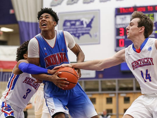 Center, Cathedral's Armaan Franklin has the ball stripped