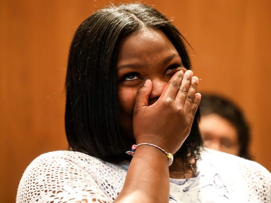 Sunshine S. Sterling, 16, of Detroit, sheds tears of joy as Detroit City Councilman Andre Spivey announces that Sterling is invited on a trip to visit HBCU's with other Detroit students after receiving an Award of Recognition.
