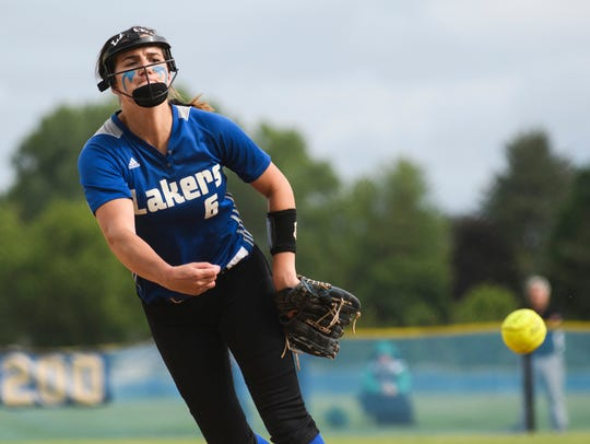 Colchester's Alli Sheets (6) delivers a pitch during