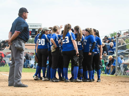 Colchester huddles together during the girls softball game between the Colchester Lakers and the Essex Hornets at Essex High School on Tuesday afternoon June 5, 2018 in Essex. (BRIAN JENKINS/for the FREE PRESS)