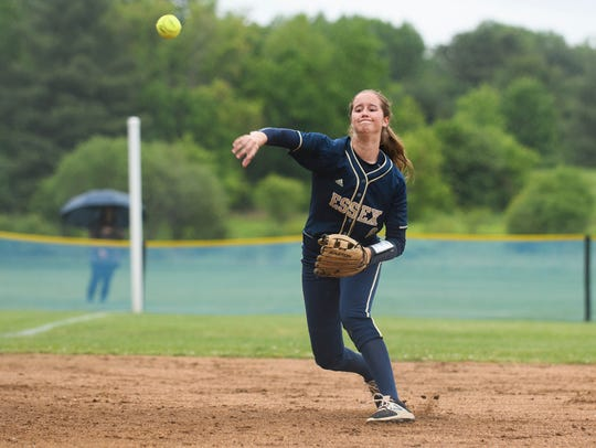 Essex's Molly Bruyns (6) throws the ball to home plate