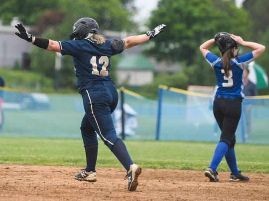 Essex's Emily Harvey (12) celebrates as she runs the bases after hitting a home run during the girls softball game between the Colchester Lakers and the Essex Hornets at Essex High School on Tuesday afternoon June 5, 2018 in Essex. (BRIAN JENKINS/for the FREE PRESS)