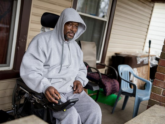 Gerald Cole sits on the front porch of his near east side home, Wednesday, Feb. 21, 2018. In October of 2016, Cole was shot and paralyzed by Indianapolis Metropolitan Police Department officer James Perry after Cole was coming to the aid of his brother, Stephen Cole, who was being apprehended by Perry.