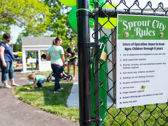 The Port Huron Parks and Recreation department unveiled Sprout City Thursday, June 7, 2018, in Port Huron. The playground offers kids the opportunity to play in a clinic, garage, bank, house, garden and other landmarks found in a typical town.