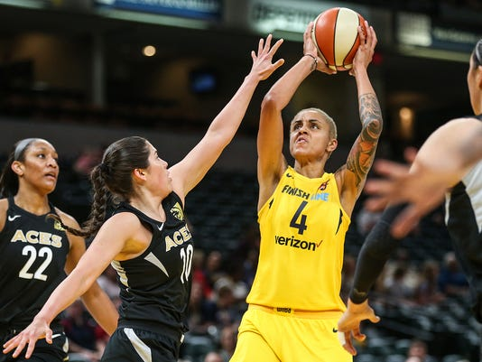 Las Vegas Aces guard Kelsey Plum (10) defends as Indiana Fever forward Candice Dupree (4) shoots  at Banker's Life Fieldhouse in Indianapolis, June 12, 2018