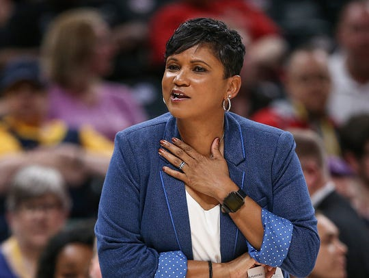 Indiana Fever head coach Pokey Chatman talks to the