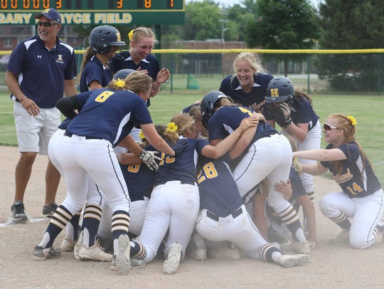 Hartland celebrates a 3-2 victory over Clarkston in