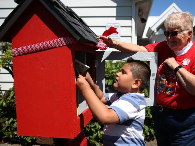 Axel Diaz, 5, of Salem, looks through available books