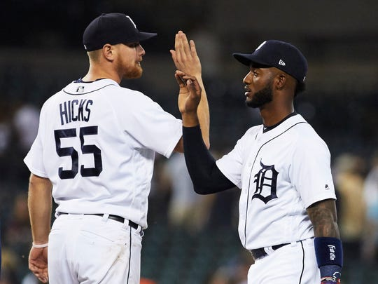 Tigers first baseman John Hicks (55) and second baseman Niko Goodrum (28) celebrate after the Tigers' 5-2 win over the Twins on Wednesday, June 13, 2018, at Comerica Park.