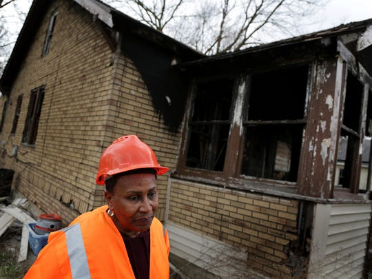 Deborah Taitt in front of a vacant home on Kilbourne street in Detroit on Friday, April 27, 2018.