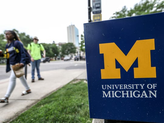 Students walk down South State Street on the University of Michigan central campus in Ann Arbor on Wednesday, June 13, 2018.