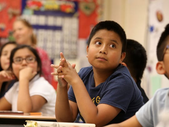 Edwin Lopez, 10, participates in his fourth grade classroom