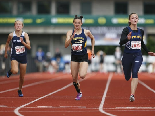 Sheridan's Ronni VanZant pushes across the finish line for the girls 100 meter race at the OSAA Track and Field State Championships at Hayward Field in Eugene on Friday, May 20, 2016.