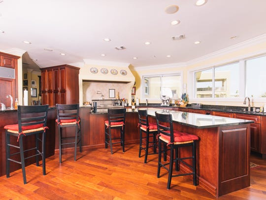 345 Deer Point, the gourmet kitchen with bar seating.