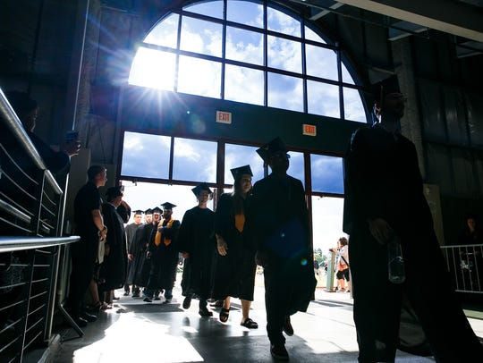 Graduates enter the pavilion at the Oregon State Fairgrounds