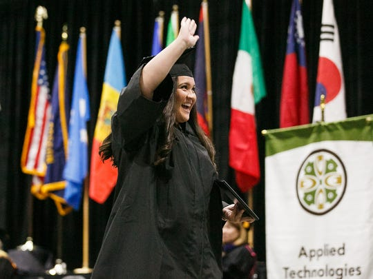 Graduates wave and celebrate after crossing the stage at the 62nd annual Chemeketa Community College graduation on Friday, June 15, 2018, at the Oregon State Fairgrounds.