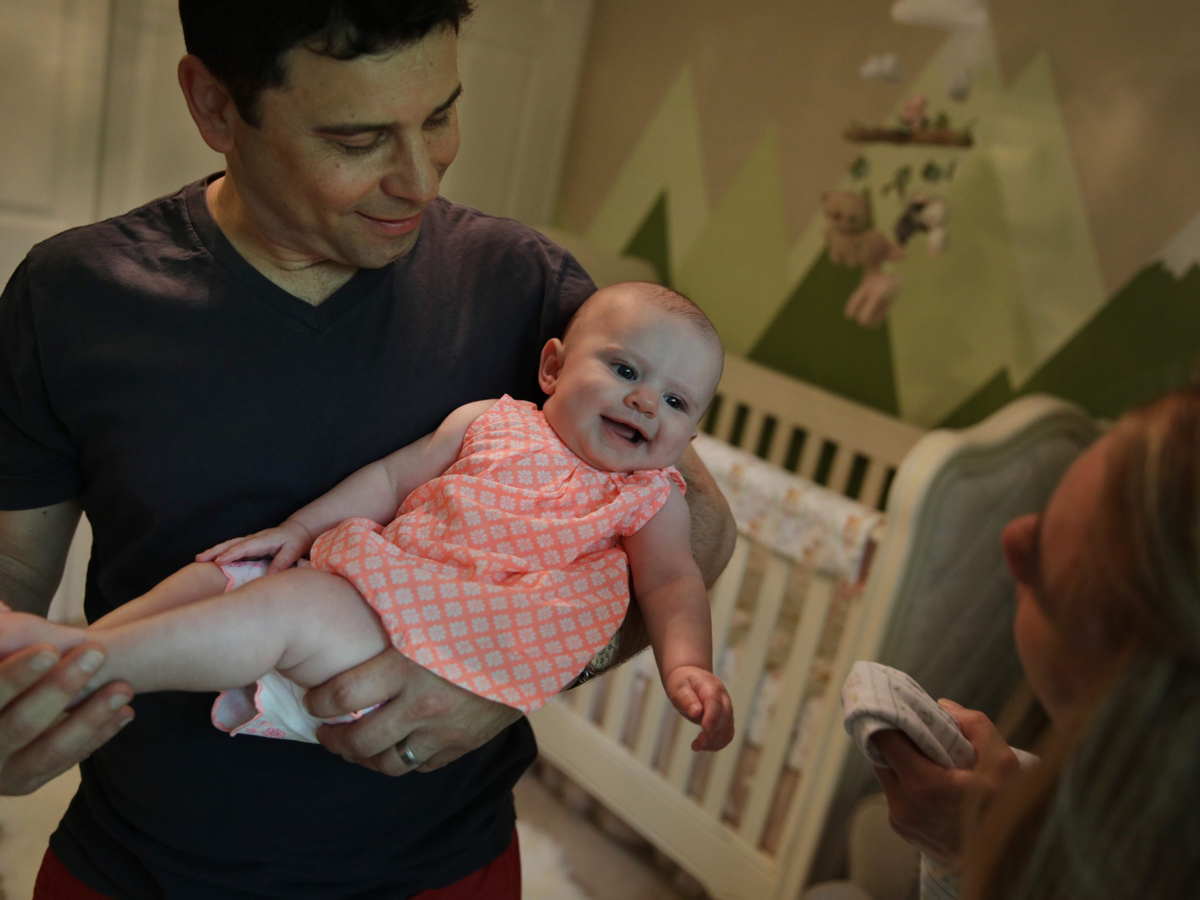Frank D'Angelo holds his five-month-old daughter Briar