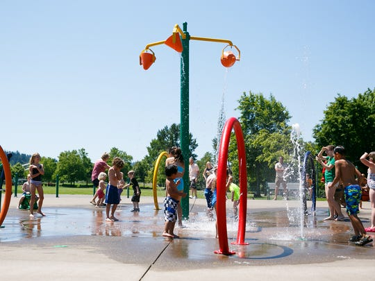 The Riverfront Park splash pad was busy on Sunday,