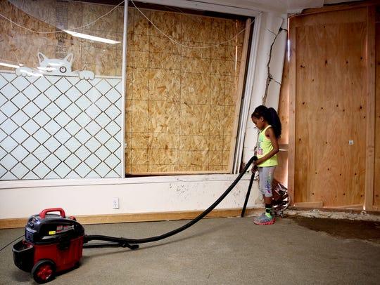 Kali Ellis, 9, of Keizer, volunteers to vacuum in the