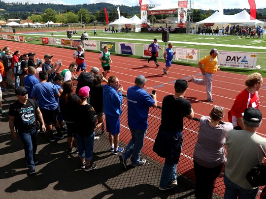 Spectators watch the 100 meter dash at the 2016 Special Olympics Oregon on Saturday, July 9, 2016, at Newberg High School.
