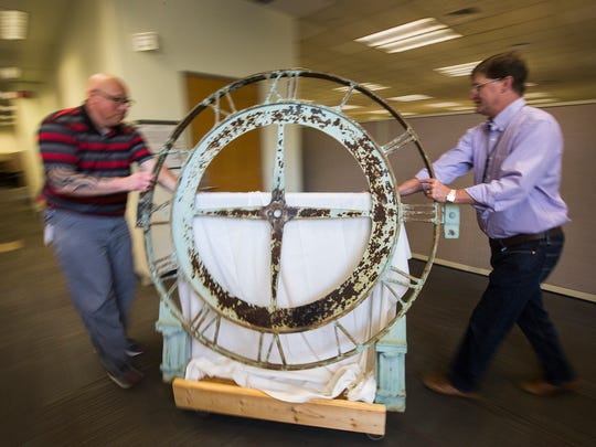 Jamie Myler, left, a research archivist at Ford, moves a clock with Ted Ryan, Ford's archivist and heritage brand manager Monday, June 18, 2018 at the Ford Engineering Lab in Dearborn. The Michigan Central Station in Detroit recently purchased by Ford, received the original skeleton of the clock tower clock anonymously.
