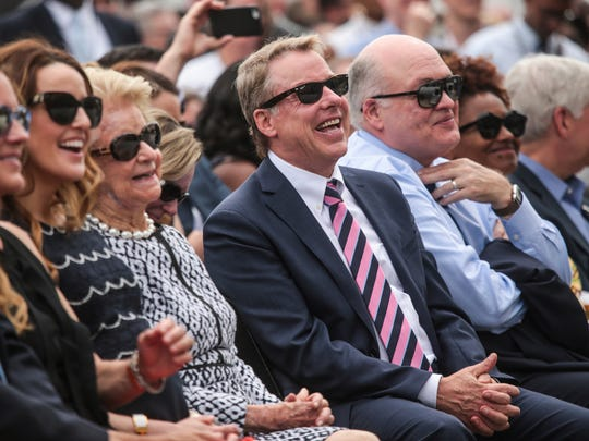 Ford Motor Company Executive Chairman Bill Ford Jr., center, laughs with his mother Martha Firestone Ford and Jim Hackett, CEO of Ford Motor Company, during the celebration of Ford Motor Company buying the Michigan Central Station in Corktown, a Detroit neighborhood, on Tuesday, June 19, 2018.