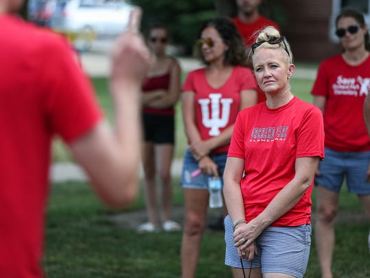 Emily Ehrgott listens as fellow parents express concerns