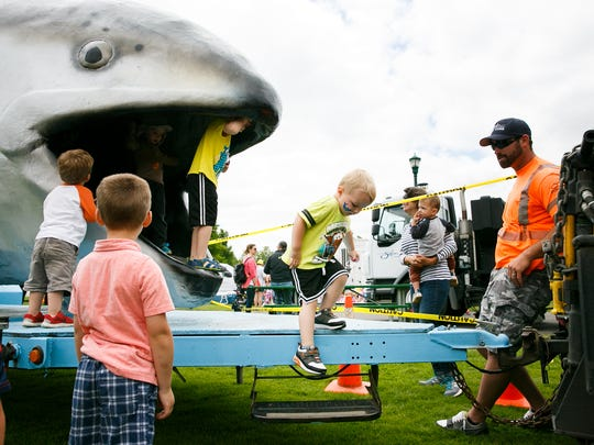 Samuel Sanders, 2, exits 29-foot-long Claudia the Chinook salmon at Salem Public Works Day on June 21, 2018, at Riverfront Park. Police, fire and other city employees were on hand to display and demonstrate city equipment in action.
