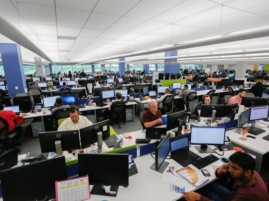 Employees fill the floor in the United Shore Financial Services new headquarter building in Pontiac on Wednesday, June 20, 2018.