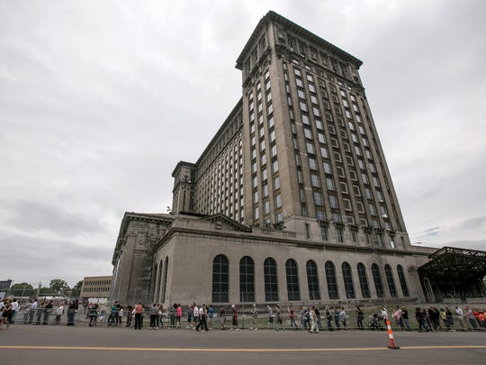 A line wraps around Michigan Central Station as the public gets a chance to see the inside of the station in Detroit during an open house put on by Ford Motor Company on Friday, June 22, 2018.