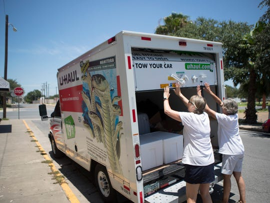 Volunteers unloads a truck of supplies for the Catholic Charities Rio Grande Valley refugee center in McAllen, Texas on Saturday, June 23, 2018.